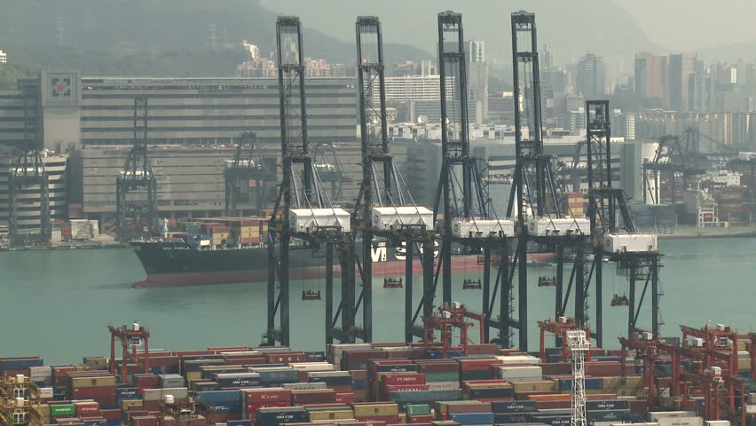 HONG KONG, CHINA - AUGUST 2012: Container Ship Arrives At Port. Shot overlooking Hong Kong container terminal in full HD on Sony EX1. - HD stock video clip