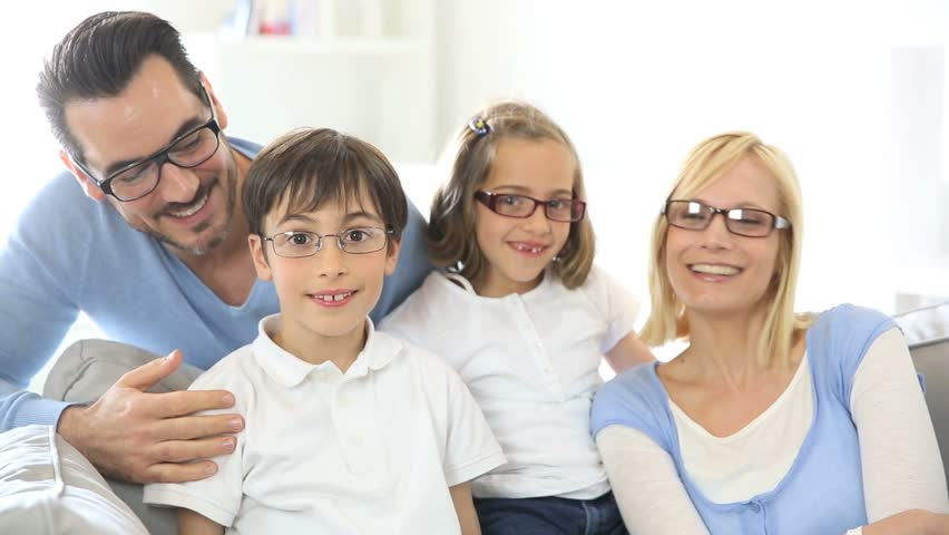 family of four wearing eyeglasses stock footage