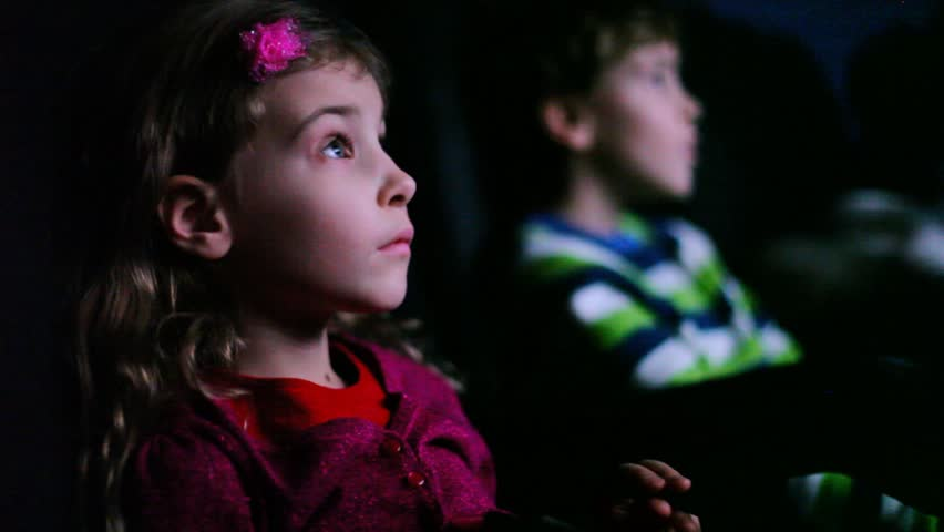 Boy and girl sitting in movie theater  - HD stock video clip