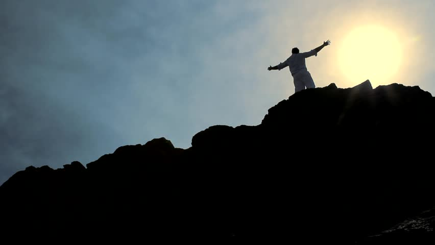 Christ Like Pose of a Man at the Top of a Hill Background HD