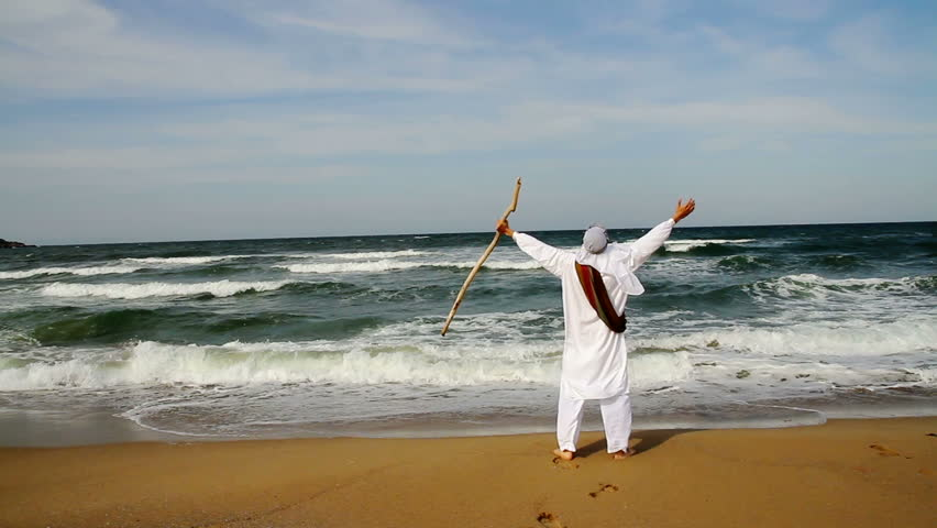 Middle Eastern Man with Staff Walking toward Sea Religious Concept HD - HD stock video clip