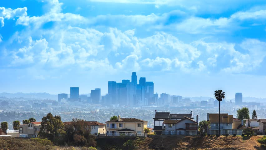 Beautiful white clouds over Los Angeles city skyline. Timelapse. - HD stock video clip