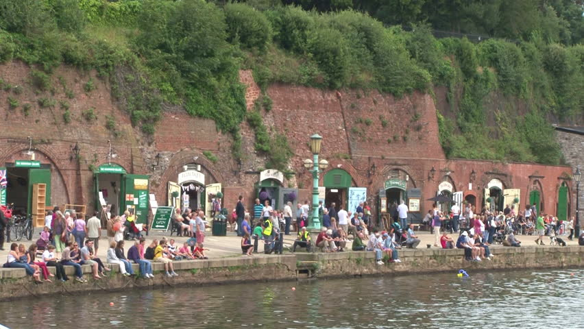 EXETER, UK - SEPTEMBER 2012: People enjoying the quayside and niche wharf shops along the river Exe in Exeter. - HD stock video clip