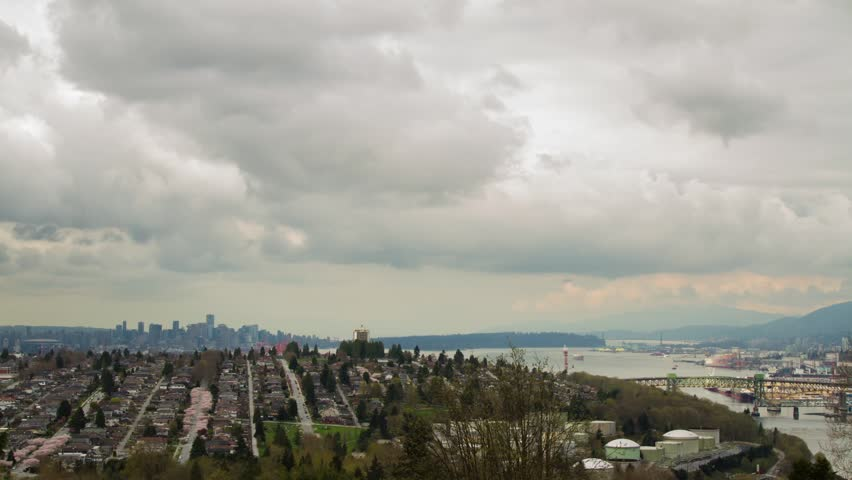 Time Lapse downtown Vancouver on a cloudy afternoon overlooking from a residential area in Burnaby. Also can see the traffic of 2nd Narrow Bridge connecting to North Vancouver on to Highway #1.