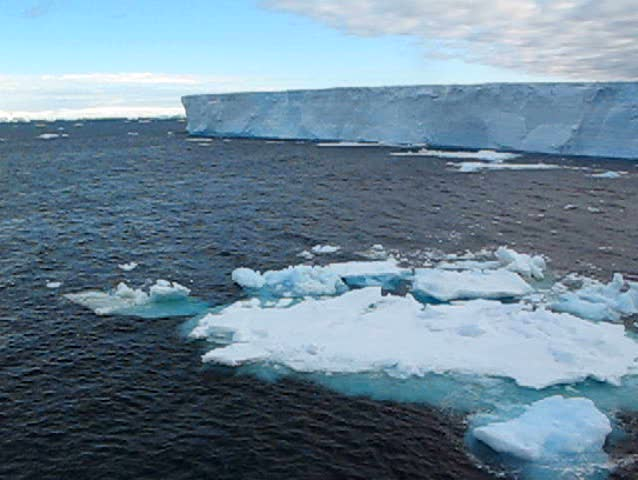 Drifting large Antarctic table iceberg - SD stock video clip