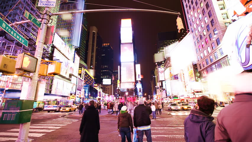 Time Lapse of busy street action on Times Square at night with brands blurred away smoothly / HD1080 / 29.97fps