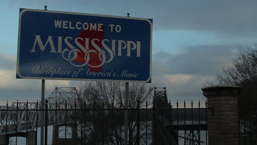 Vicksburg, Mississippi - February, 2013 - Wide shot of the Welcome to Mississippi sign along the Mississippi River.