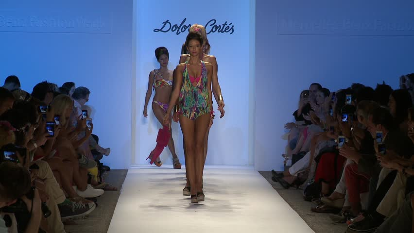 MIAMI - JULY 20: Models walks runway finale at the Dolores Cortez Collection for Spring/ Summer 2013 during Mercedes-Benz Swim Fashion Week on July 20, 2012 in Miami, FL