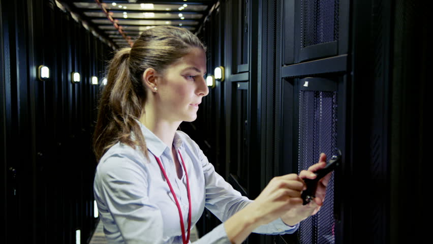 Woman checking the equipment  in data center.
