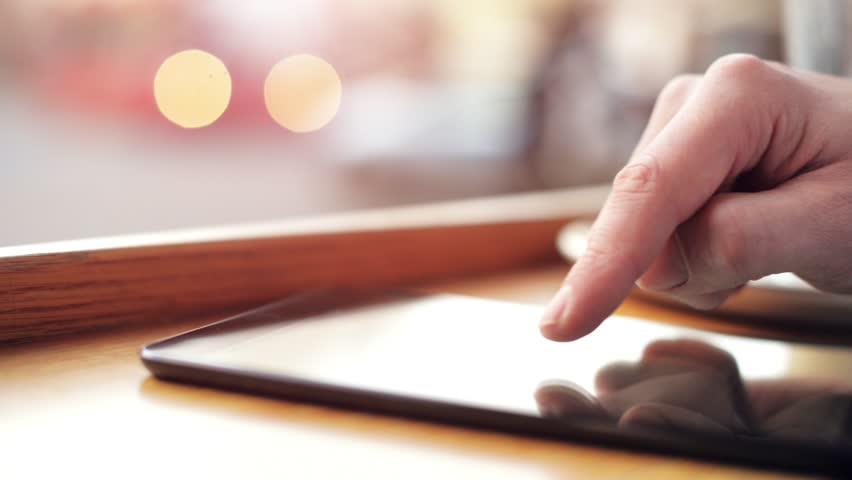 Man hand using tablet computer pc  commuter in background - HD stock footage clip