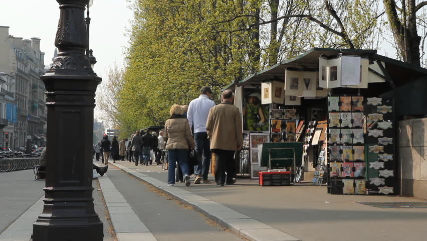 PARIS, FRANCE on APRIL 9th: Booksellers on the banks of the Seine on April 9th, 2012, Paris, France. The Bouquinistes of Paris, France, are booksellers of used books who set up shop by the Seine.