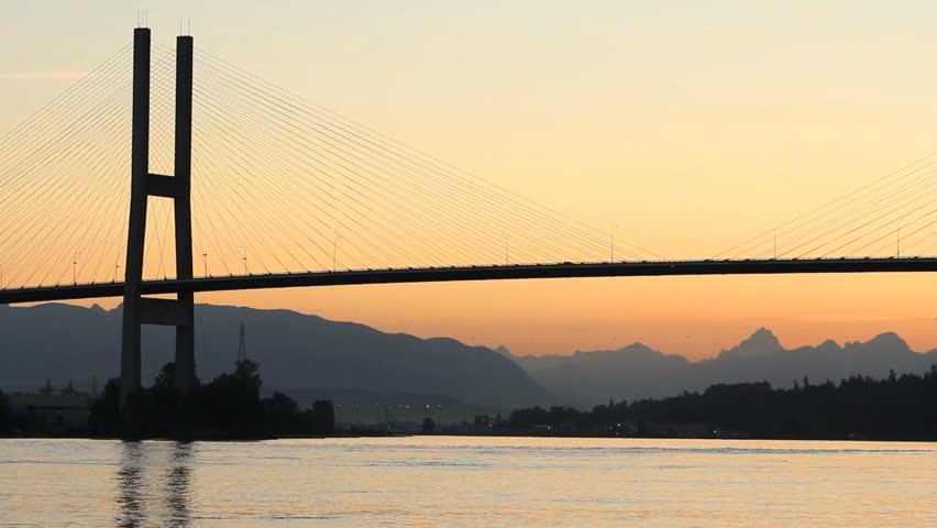Twilight Alex Fraser Bridge, Vancouver. The Alex Fraser Bridge, just before sunrise, spanning the Fraser River at Delta, BC near Vancouver. Canada.  - HD stock video clip