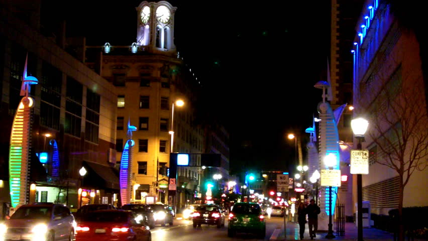 LONG BEACH, CA: February 19, 2013- Shot of the famous Pine Avenue in downtown circa 2013 in Long Beach. Clip features a busy downtown night which is great for showing city shots at night. - HD stock footage clip