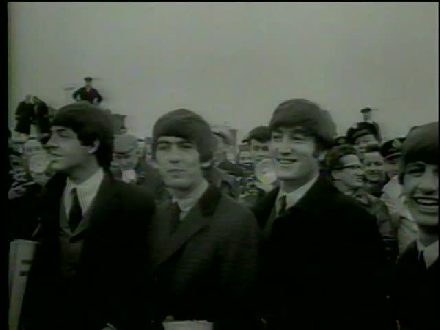 British rock'n'roll band the Beatles poses in Heathrow Airport, London circa 1964-MGM PICTURES, UNIVERSAL-INTERNATIONAL NEWSREEL, USA, filmed in 1964