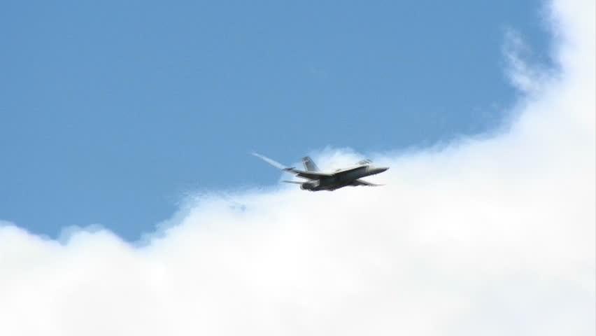 US Navy jet performing aerobatics.