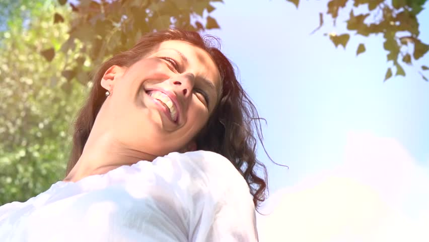 Beautiful Young Woman Outdoor. Enjoy Nature. Beauty Healthy Girl Relaxing in a Park. Healthy Skin and Hair. Countryside. Slow Motion video footage - HD stock footage clip