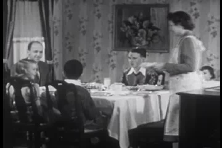 1950s - A family states what they are thankful for over Thanksgiving dinner in the 1950s