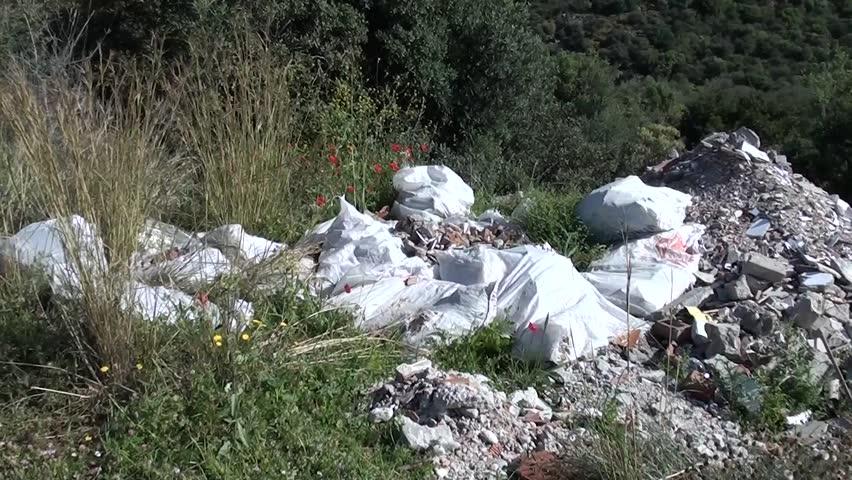 Material debris dump in the forest, tilt up