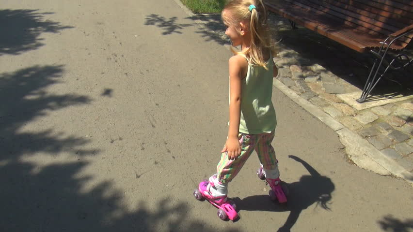 POV Child Walking with Roller Skates on Path in Park, Little Girl Making Sport - HD stock footage clip