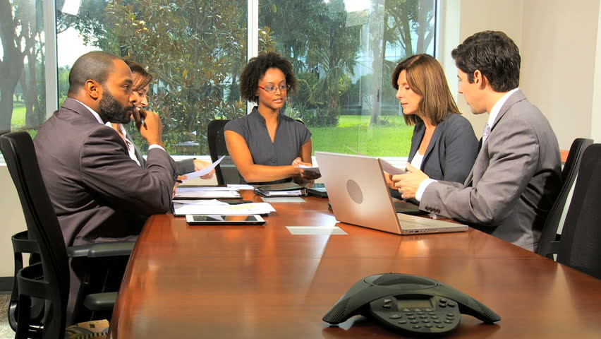 Young female African American team leader chairing boardroom meeting with successful multi ethnic business colleagues