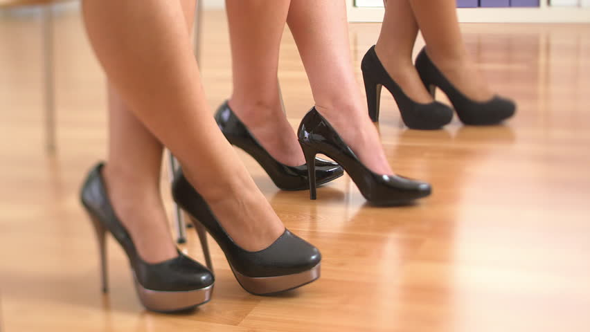 Close up of three business women's feet in high heels tapping their feet