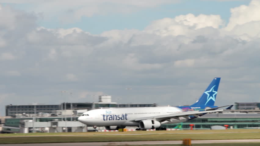 MANCHESTER, LANCASHIRE/ENGLAND - JULY 30: Air Transat airbus A330 taxis past control tower on July 30, 2013 in Manchester. Air Transat is a Canadian airline based in Montreal, Quebec.