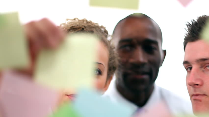 Business people post message on glass screen. High quality HD video footage - HD stock video clip