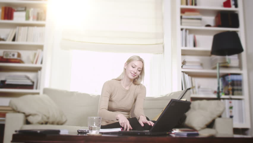 Young woman studying with laptop