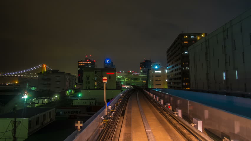 TOKYO, JAPAN - AUGUST 24: Time lapse from the Yurikamome on July 8, 2013, an automated guideway transit service operating along Tokyo Bay in Tokyo, Japan.