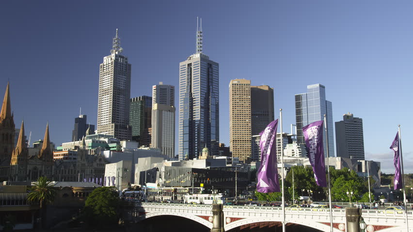 Skyline of CBD East Melbourne with Tram passing on Princess Bridge