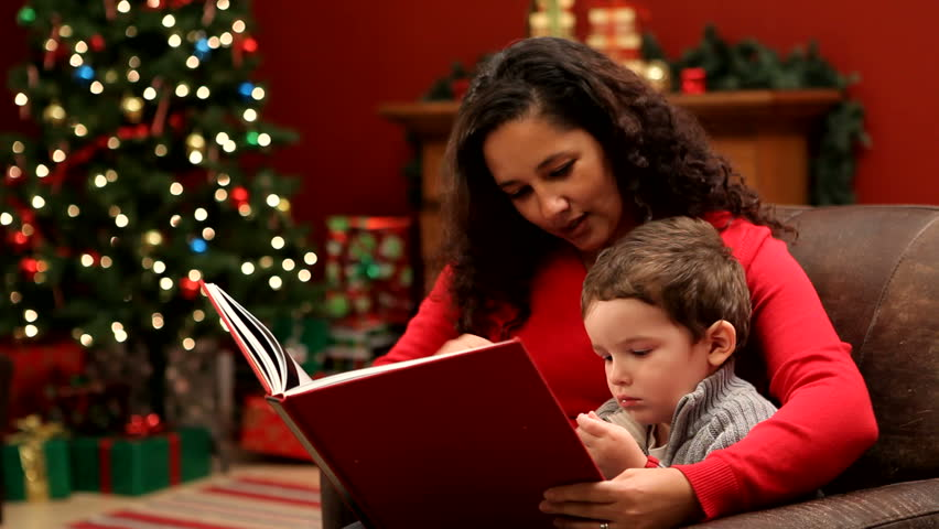 Mother reading Christmas book to son - HD stock footage clip
