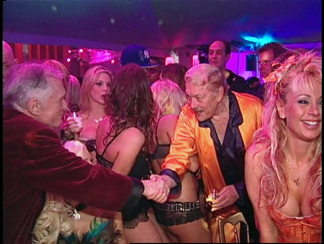 LOS ANGELES - April 9, 2006: Hugh Hefner and Jerry Buss at the Hugh Hefner 80th Birthday Party 2006 in the Playboy Mansion in Los Angeles April 9, 2006