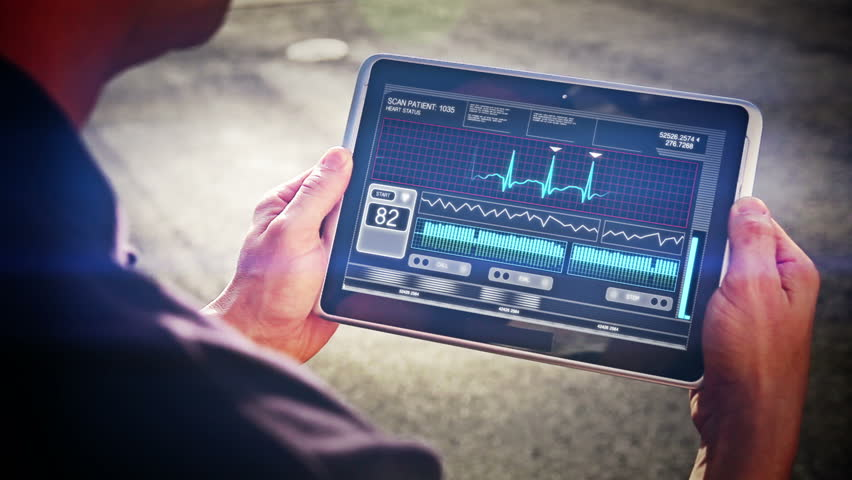 A doctor looks at a futuristic mobile health device.