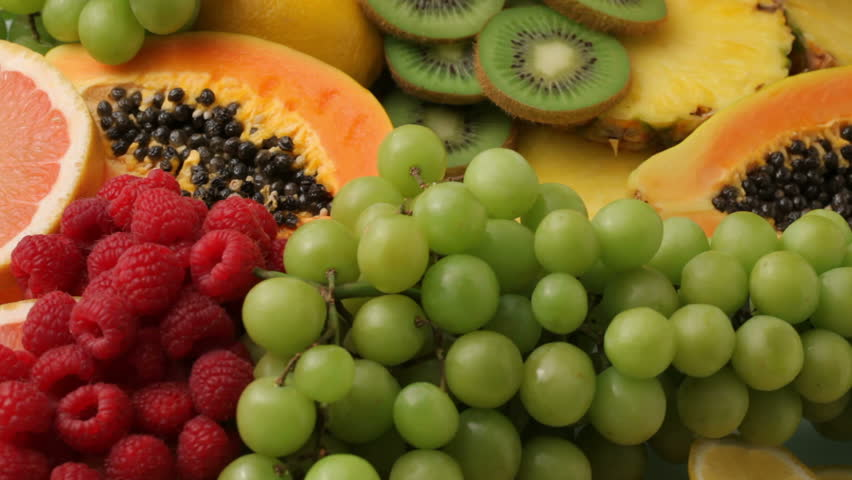 Fresh fruits background, fly over