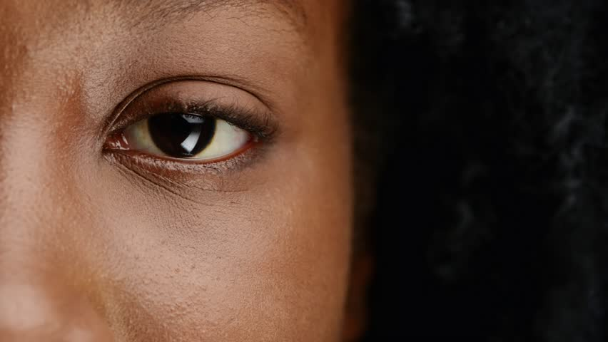 close up african woman eye character series isolated on pure white background - HD stock footage clip