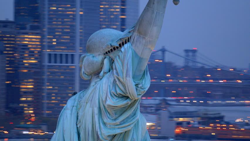 Statue of Liberty at dusk, closeup aerial shot