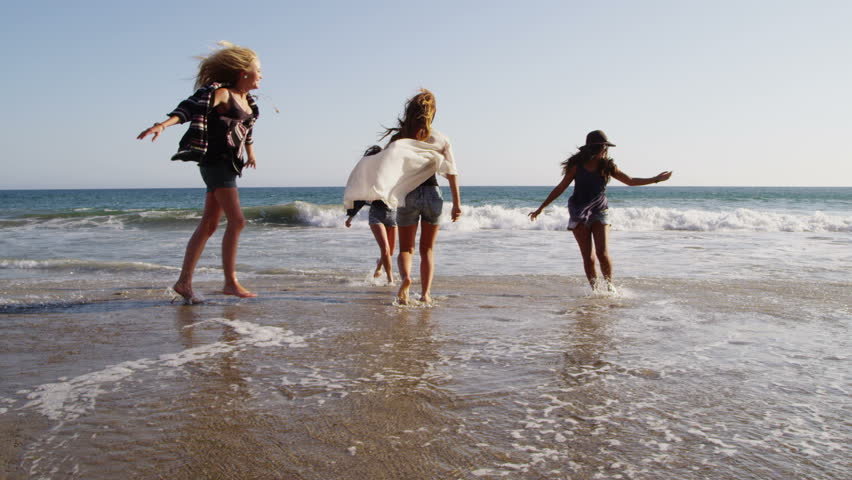 Group of young people together at beach