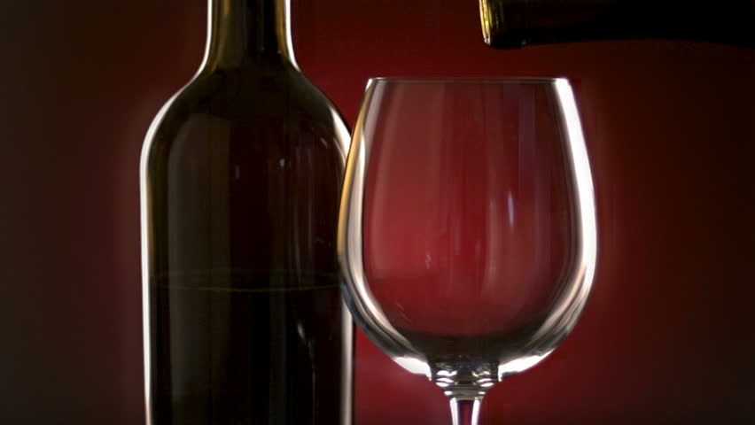 Pouring glass of wine, slow motion - HD stock footage clip