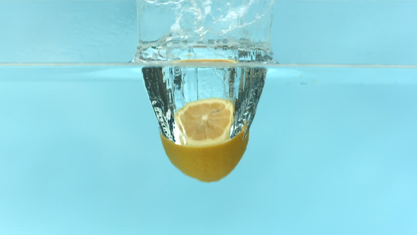 Lemon falling into water, slow motion