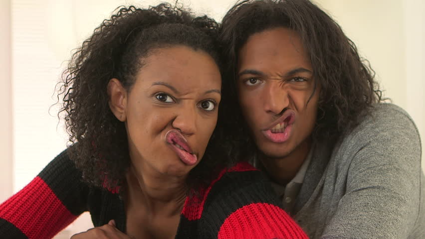 Black couple making funny faces at the camera - HD stock footage clip