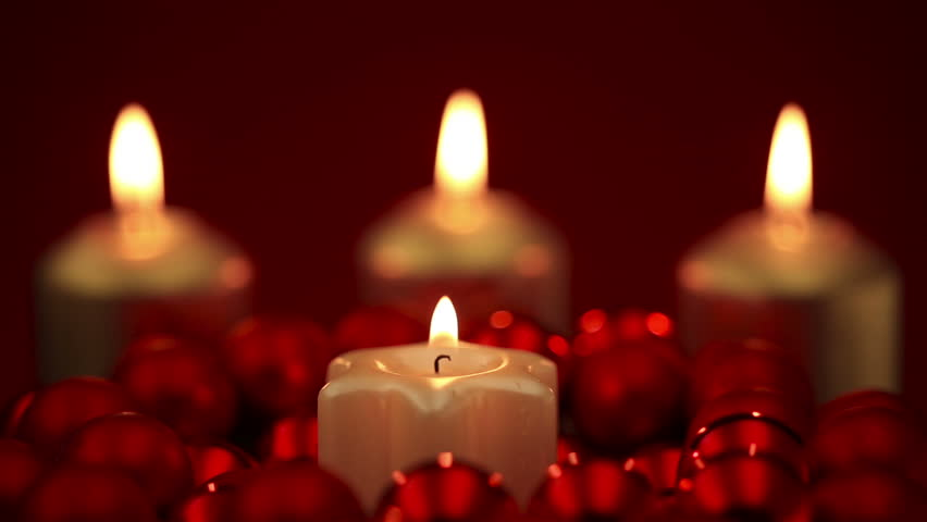 Lighting And Blowing Out Four Advent Candles At Christmas On A Black ...