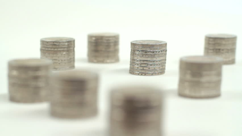 Male hand picking up a pile of euro coins. High definition video on white studio background.