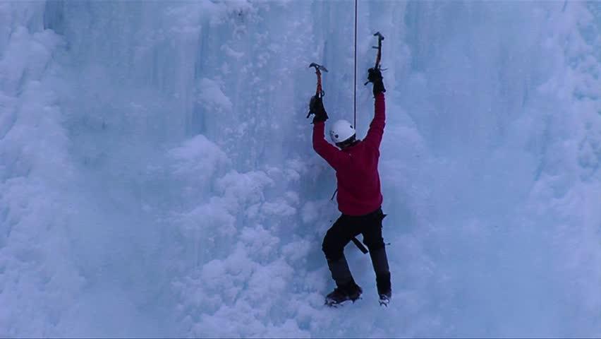 ONTARIO, CANADA-CIRCA 2012-A man climbing a frozen waterfall. - HD stock video clip