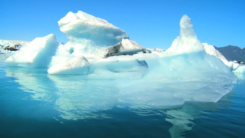Glacial ice slowly melting into the lake through global warming 60 FPS - HD stock footage clip