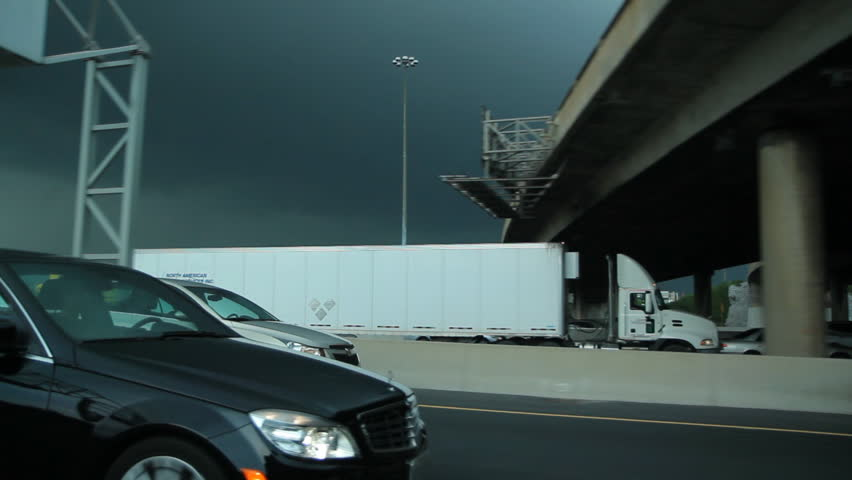 TORONTO, CANADA on  MAY 21st:  Approaching storm on the 401 Highway in Toronto, Canada on May 21, 2013. The segment of Highway 401 passing through Toronto is the busiest highway in North America. - HD stock footage clip