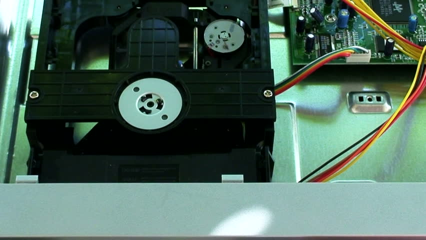 Looking inside a dvd player - HD stock video clip