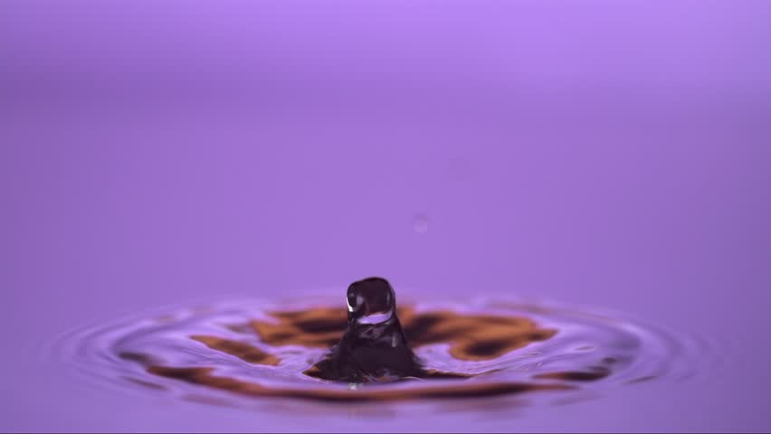 a slow motion water drop hitting another water drop, water color purple/orange/white, shot with high speed camera Weisscam HS-2
