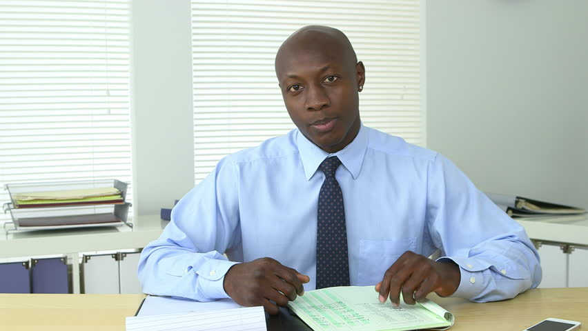 African American business man holding video conference