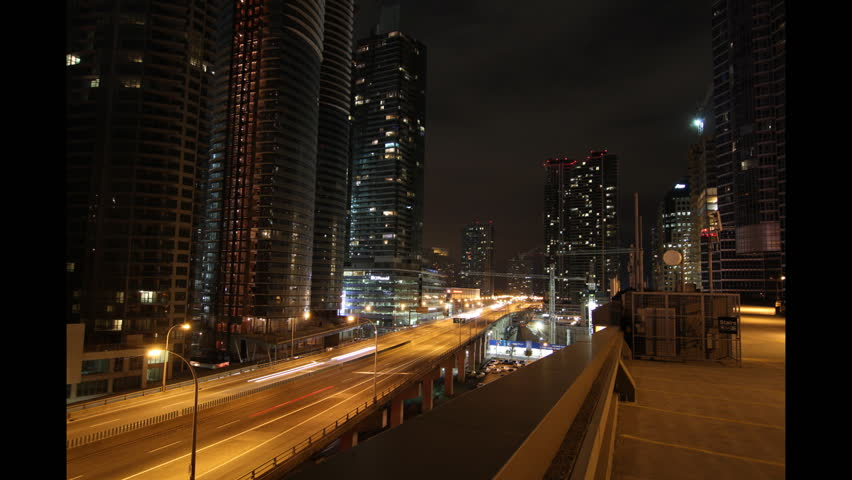 Toronto highway at night. Timelapse. Zoom out. Timelapse and slow zoom out of Gardiner expressway at night in downtown Toronto. Looking east. Clip is assembled from hi-res stills.