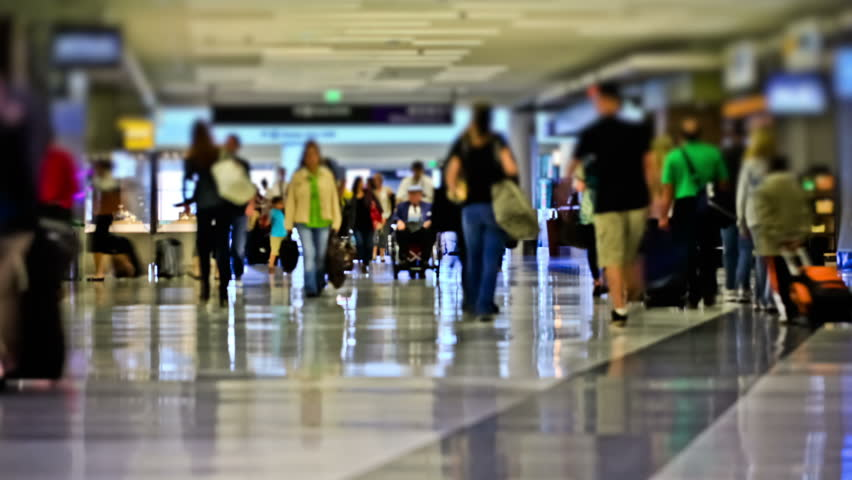 Airport travelers time lapse using a photo effect.